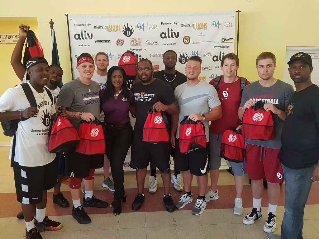 Latia Duncombe presents RUBiS backpacks to workshop coaches